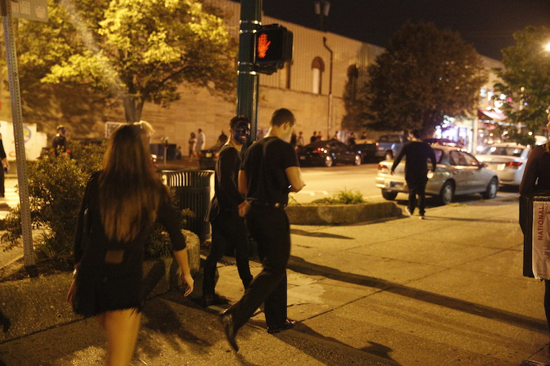 Bloomington, Indiana, Sept. 17 -- A group of white men and women in their early 20s with black paint on their faces cross Sixth Street while walking up North Walnut Street about 11:30 p.m. There are several bars on Walnut between Sixth and Eighth Streets that are popular with IU students.